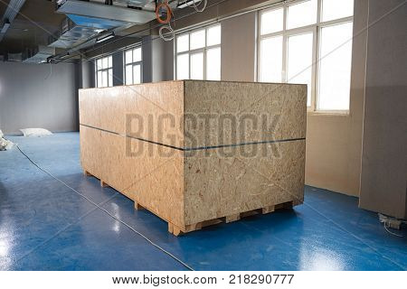 Wooden container in warehouse.
