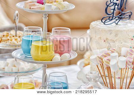 Buffet table with different treats for baby shower party indoors