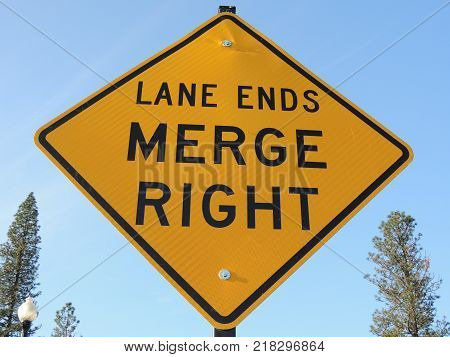 Yellow and black lane ends, merge right diamond traffic sign