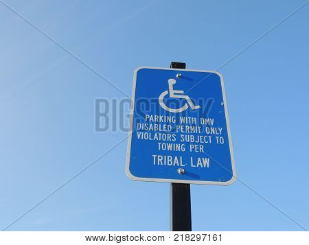 Blue and white parking space sign for disabled people