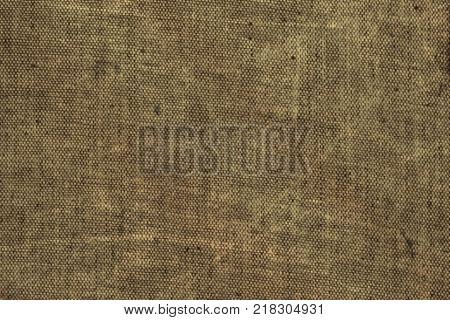 Coarse fabric dark beige texture natural jute canvas sacking background copyspace for text