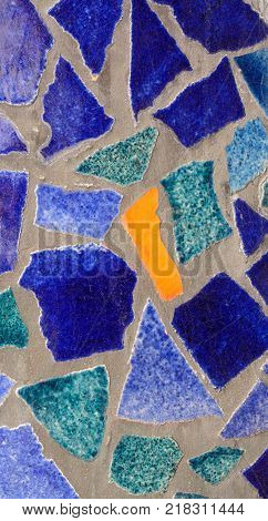 Mosaic of blue shades and orange of a different form