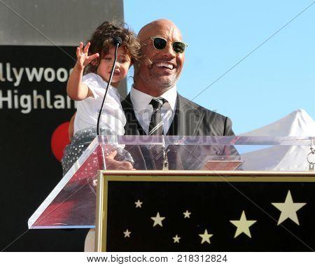 LOS ANGELES - DEC 13:  Jasmine Johnson, Dwayne Johnson at the Dwayne Johnson Star Ceremony on the Hollywood Walk of Fame on December 13, 2017 in Los Angeles, CA