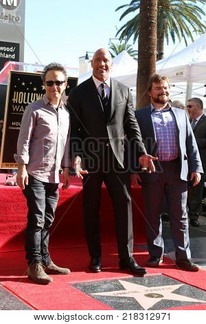 LOS ANGELES - DEC 13:  Jake Kasden, Dwayne Johnson, Jack Black at the Dwayne Johnson Star Ceremony on the Hollywood Walk of Fame on December 13, 2017 in Los Angeles, CA