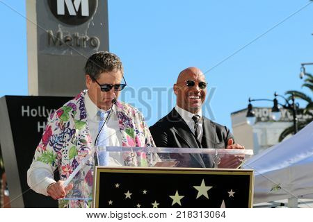 LOS ANGELES - DEC 13:  Thomas Rothman, Dwayne Johnson at the Dwayne Johnson Star Ceremony on the Hollywood Walk of Fame on December 13, 2017 in Los Angeles, CA