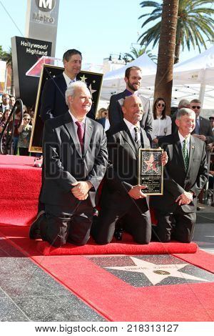 LOS ANGELES - DEC 13:  Thomas Rothman, Dwayne Johnson, Leron Gubler, Officials at the Dwayne Johnson Star Ceremony on the Hollywood Walk of Fame on December 13, 2017 in Los Angeles, CA