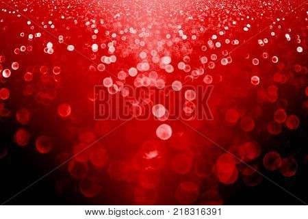 Fancy abstract dark ruby red black glitter sparkle confetti background for happy birthday party invite, New Year Eve night, Christmas sale lights blur, celebrate wedding or Valentine's Day love beauty