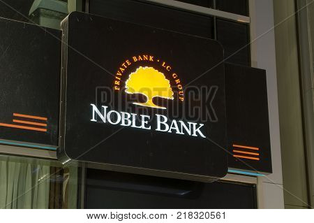 Gdansk, Poland - December 9, 2017: Noble Bank sign and logo at night time.
