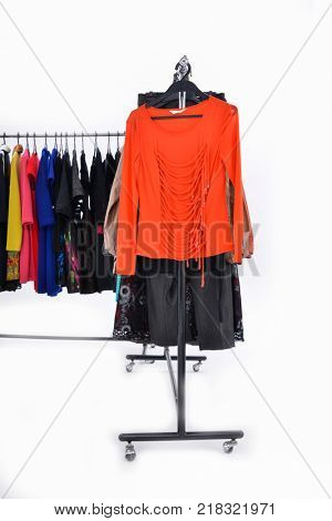 Variety of casual female different clothes for females on hanger