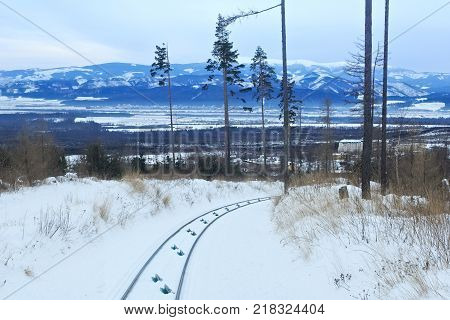 View of the funicular railway at High Tatras mountains National park in Slovakia. Railroad leads to popular ski and tourist resort Hrebienok (altitude 1285 m.) from Stary Smokovec village.