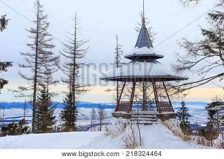 Wooden viewpoint in the popular ski and hiking Hrebienok resort (altitude 1285 m.) located in the High Tatras mountains National park. Slovakia.