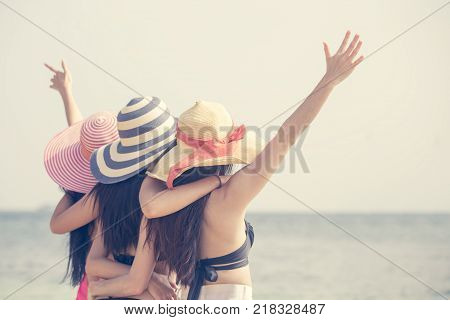 Portrait Of Behind Woman Group Posing At The Beach, People With Summer Concept. Vintage Tone.