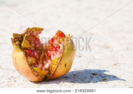 Ripe and juicy pomegranate isolated on homogeneous background