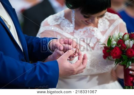 Belarus Gomel September 29 2017 Wedding Feast.The groom dresses the bride's engagement ring.To put on an engagement ring