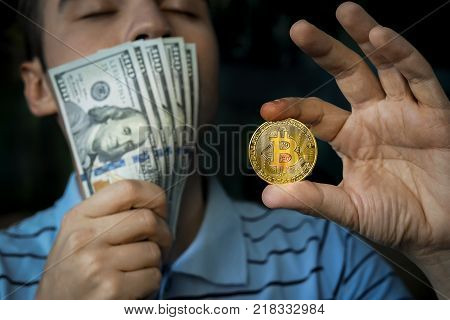 Guy Holding The Coin Bitcoin And Money In Hand.