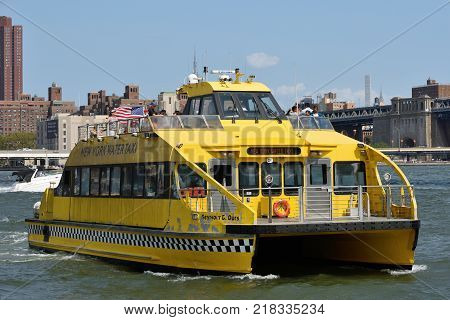 NEW YORK CITY - AUG. 27: NY Water Taxi on the East River on August 27 2017 in New York City NY. Water taxi service based in New York City offering sightseeing and charter services.