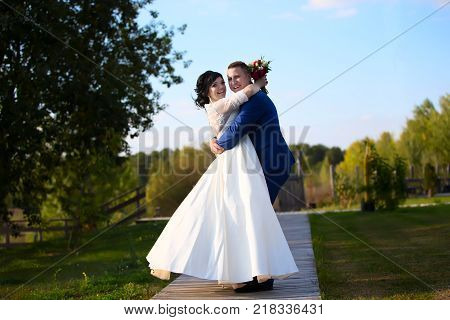 Belarus Gomel September 29 2017 Wedding Feast.Happy bride and groom on a walk in nature. The bride and groom on a walk