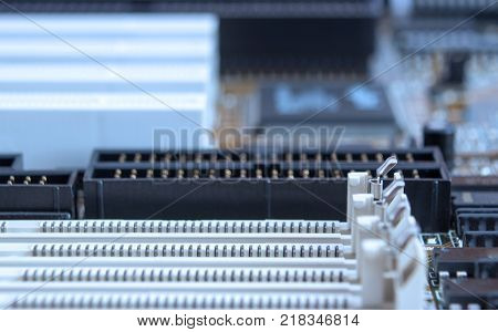 On board are capacitors resistors slots integrated circuits microprocessor.
