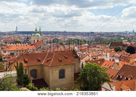 Scenic view of old buildings at the Mala Strana District (Lesser Town) and beyond in Prague, Czech Republic. Viewed slightly from above in the daytime.