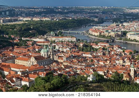 View of St. Nicholas Church at the Mala Strana District (Lesser Town) and Vltava River in Prague, Czech Republic, from above.