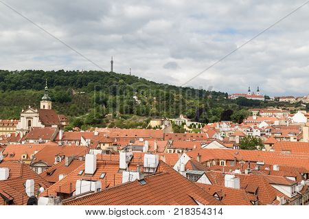 View of old buildings from above and Petrin Hill at the Mala Strana District (Lesser Town) in Prague, Czech Republic.