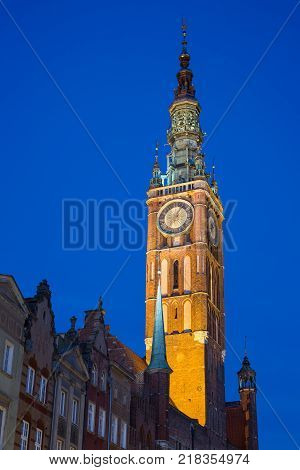 View of the Main Town Hall's lit tower in Gdansk, Poland, in the evening. It's located at Long Market Street (Long Lane) in the Main Town (Old Town).
