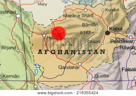 Close-up of a red pushpin on a map of Afghanistan.