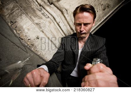 drunk guy looking if there's anything left in the bottle
