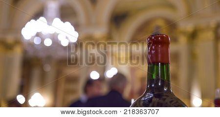 Row Of Vintage Wine Bottles In Luxury Wine Cellar