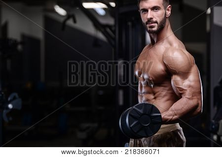 sexy strong bodybuilder athletic fitness man pumping up abs muscles workout bodybuilding concept background - muscular bodybuilder handsome men doing fitness health care exercises in gym naked torso