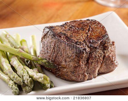 seared tenderloin steak with asparagus.
