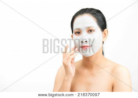 Young woman clay face mask peeling natural with purifying mask on her face on white background