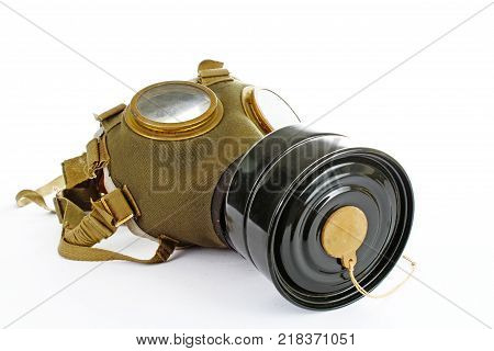 Gas mask from ww2 real war. Used vintage green and black gas mask can illustrate danger, war, catastrophe, or other concept. Gas mask on isolated white studio background. Easy to use for your work. War mask.