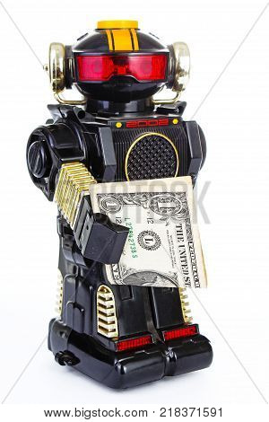 Robot on white background. Classic robot retro toy. . Classical black plastic alloy robot with money. Electronic robotic robot holding money. White background. poster