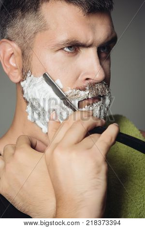 happy hipster in barbershop new technology. Haircut of bearded man archaism. Fashion and beauty innovation. Barber and hairdresser. Man cut beard and mustache with razor and shaving brush.
