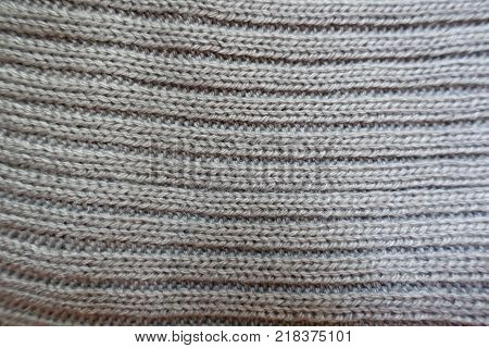Top view of grey handmade rib knit fabric