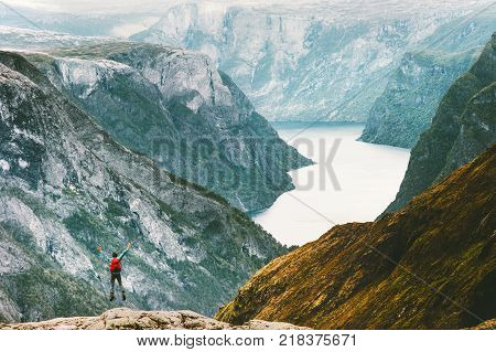 Jumping Man at Naeroyfjord mountains landscape Travel Lifestyle concept adventure active vacations outdoor hiking sport in Norway happy emotions