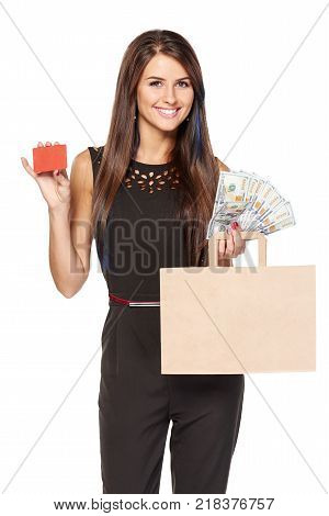 Different ways of payment. Smiling woman holding paper shopping bag with blank copy space for text and cash US dollars in one hand and blank credit card in other, over white background