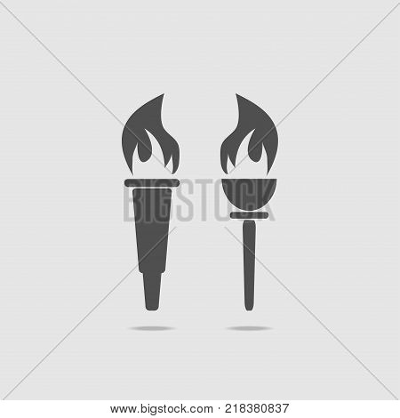 Set of two torches with fire. On a light background, in gray. Icon torch. Vector illustration.