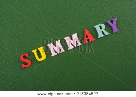 SUMMARY word on green background composed from colorful abc alphabet block wooden letters, copy space for ad text. Learning english concept