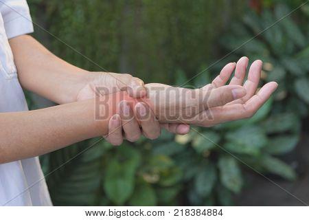 Man holding his wrist. Pain in a man wrist. Man massaging painful wrist. pain concept.