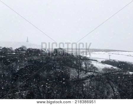 stoodley pike and surrounding moors in heavy snow in west yorkshire
