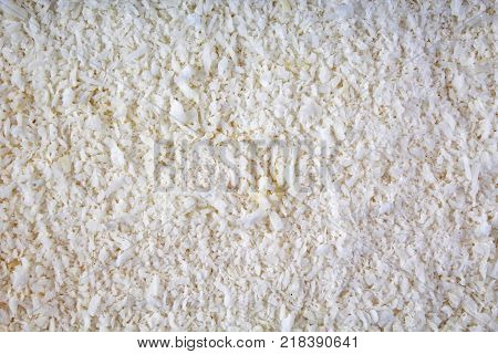 Desiccated coconut texture pattern as background. Coco desicatted coconut texture.