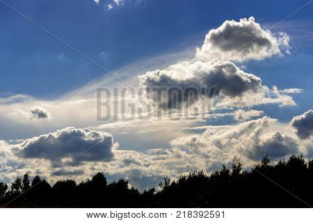 Cumulus altostratus and stratocumulus clouds on the blue sky