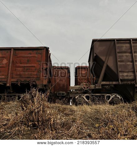Railway freight cars. Freight railway station. Freight cars. Grunge background. Grunge freight cars.