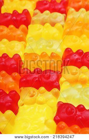 Gummy bear background. Gummy bears as texture. Gum bear candy colorful pattern. Gum bears.