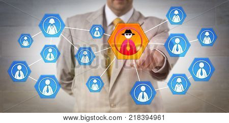 Unrecognizable cyber security manager identifying inside attack in a corporate network. Information technology concept for insider threat cybersecurity corporate espionage and criminal profiling.