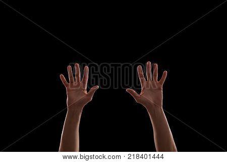 Raised hands in the dark on rock music concert