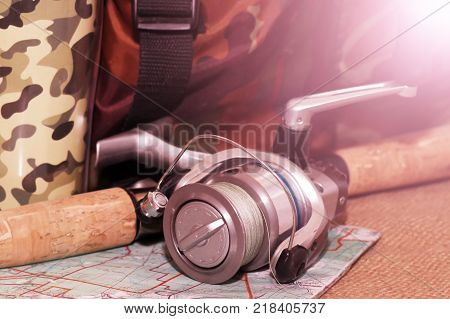 Fishing Reel And Lures Colored In The Sunlight