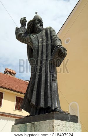 VARAZDIN, CROATIA - JULY 09: Statue of Gregory of Nin, medieval Croatian bishop of Nin in front of Saint John the Baptist church in Varazdin, Croatia on July 09, 2016.